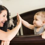 sleep benefits motherhood, mom and baby high five