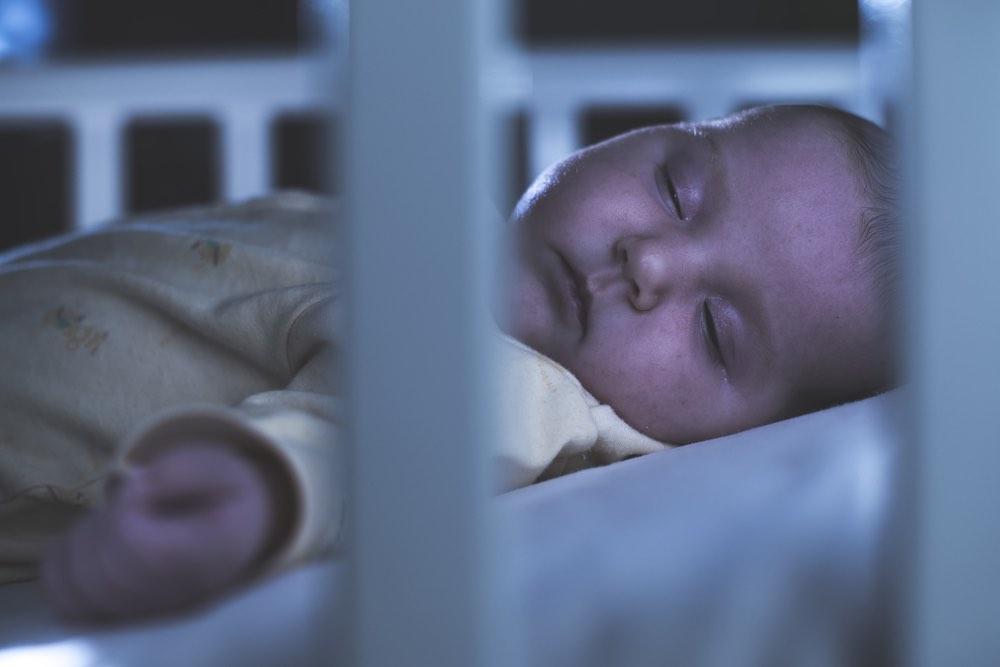 sleeping infant through crib at night
