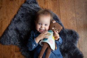 toddler with a lovey, teddy bear
