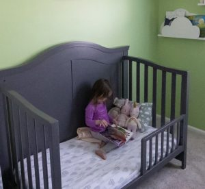 toddler in a big kid bed